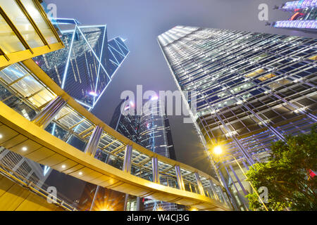 Cityscape modern office buildings in central Hong Kong at night - Stock Photo