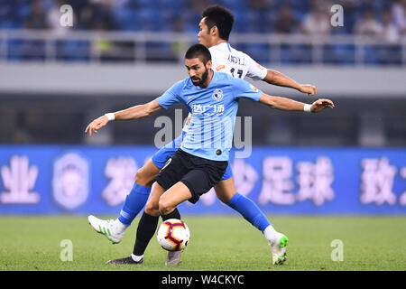 Belgian football player Yannick Ferreira Carrasco, front, of Dalian Yifang F.C. plays during the 19th round of Chinese Football Association Super League (CSL) against Tianjin TEDA in Tianjin, China, 20 July 2019. The match ended with a tie 3-3. - Stock Photo