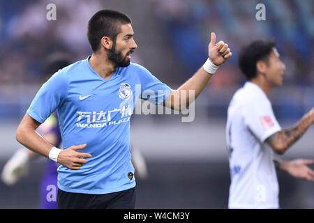 Belgian football player Yannick Ferreira Carrasco of Dalian Yifang F.C. plays during the 19th round of Chinese Football Association Super League (CSL) against Tianjin TEDA in Tianjin, China, 20 July 2019. The match ended with a tie 3-3. - Stock Photo