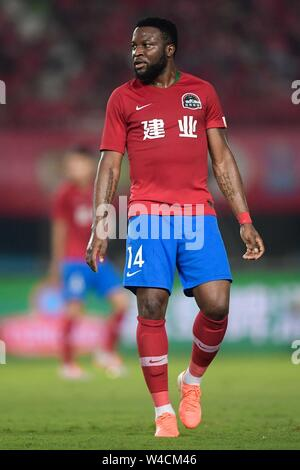 Cameroonian football player Franck Ohandza of Henan Jianye F.C. walks on the ground during the 19th round of Chinese Football Association Super League (CSL) against Wuhan Zall in Zhengzhou, central China's Henan province on 21 July 2019. The match ened with a draw 0-0. - Stock Photo
