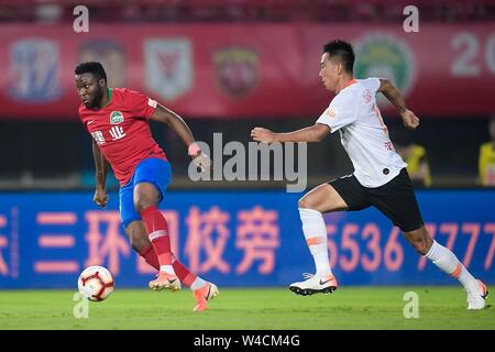 Cameroonian football player Franck Ohandza of Henan Jianye F.C. keeps the ball during the 19th round of Chinese Football Association Super League (CSL) against Wuhan Zall in Zhengzhou, central China's Henan province on 21 July 2019. The match ened with a draw 0-0. - Stock Photo