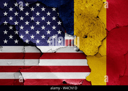 flags of USA and Chad painted on cracked wall - Stock Photo