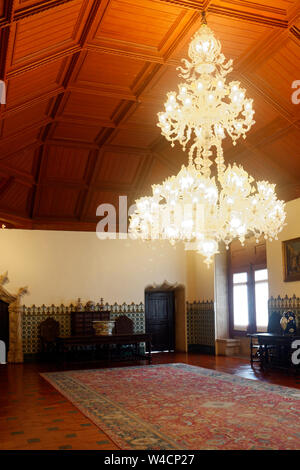 large chandelier lighted, ornate, wood ceiling, oriental rug, Palacio National; UNESCO site; 14th century Romanticism style; Europe, Sintra; Portugal; - Stock Photo