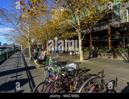 Boardwalk for shoppers on Southbank Yarra river side in Melbourne city CBD, Australia - Stock Photo