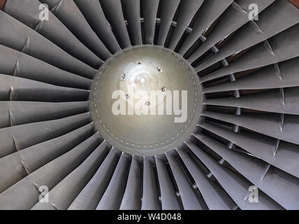 Details of a large jet engine, showing the fan blades and central hub. - Stock Photo