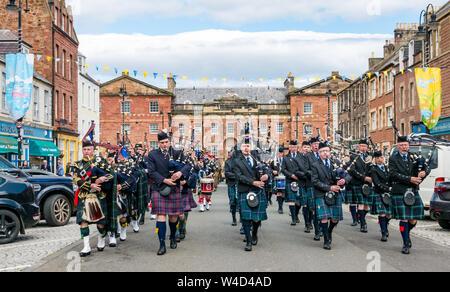 Traditional Scottish pipe band parades down High Street, Dunbar, East Lothian, Scotland, UK - Stock Photo