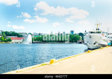 Lappeenranta, Finland - June 20, 2019: Summer landscape with fountain and boats in Lappeenranta harbor on Saimaa lake. - Stock Photo