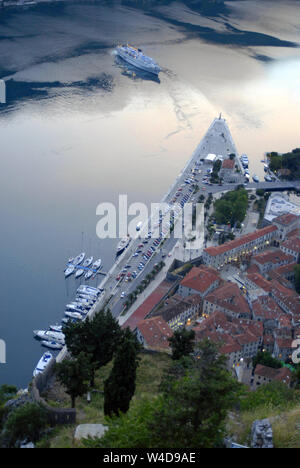 Cruise ship on the water nearby the pier. Kotor, Montenegro. Top view - Stock Photo
