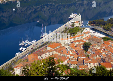 Old city pier and mountain reflection on the water. Top view. Kotor, Montenegro - Stock Photo
