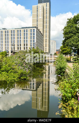 CARDIFF, WALES - JULY 2019: New stduent accommodation in Cardiff city centre operated by Zenith. The building is reflected in the still water of a can - Stock Photo
