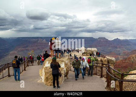People at a scenic lookout with great views in the Grand Canyon National Park - Stock Photo