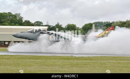 Spanish Navy AV-8B Harrier IIs landing at on a very wet runway creating lots of vapour and steam at the 2019 Royal International Air Tattoo - Stock Photo