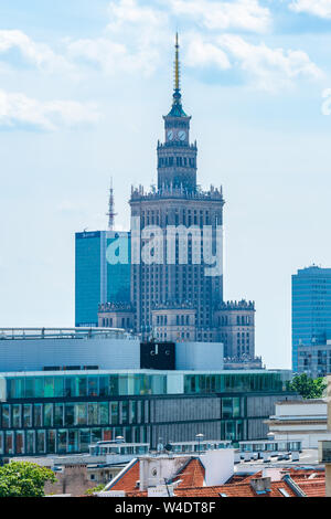 WARSAW, POLAND - JULY 19, 2019: Warsaw's widely varied architecture reflects the city's turbulent history from Gothic churches and neoclassical palace - Stock Photo