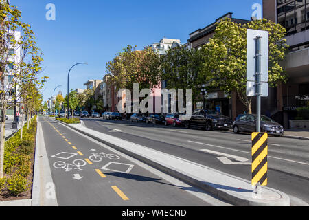 Multi-direction bike lane in Victoria, BC on clear, sunny day. - Stock Photo