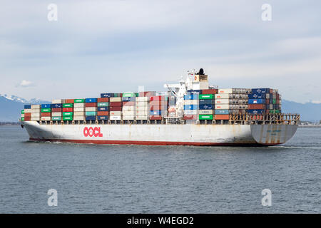 OOCL Antwerp Container Ship near its destination, the Port of Vancouver arriving from Kaohsiung, Taiwan. - Stock Photo