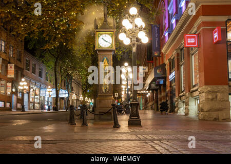 World-famous Gastown Steam Clock on Water St. in downtown Vancouver, BC at night. - Stock Photo