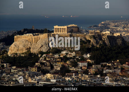 Sunrise over the Acropolis as seen from Lycabetus Hill in Athens, Greece. - Stock Photo