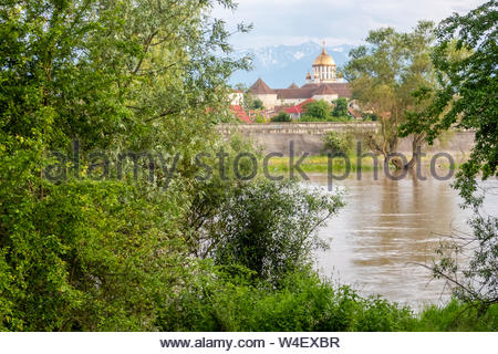 View of the Orthodox Cathedral of Fagaras against a backdrop of the Carpathian mountains, from the north bank of the Olt river. Transylvania, Romania. - Stock Photo