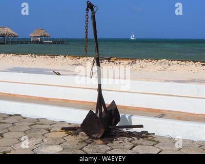 Anchor on the beach in Ambergris Caye, Belize tropical caribbean. - Stock Photo