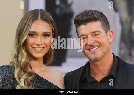 Los Angeles, USA. 22nd July, 2019. April Love Geary, Robin Thicke at Sony Pictures' 'Once Upon a Time.in Hollywood' World Premiere held at the TCL Chinese Theatre, Los Angeles, USA, July 22, 2019. Photo Credit: Joseph Martinez/PictureLux All Rights Reserved Credit: PictureLux/The Hollywood Archive/Alamy Live News - Stock Photo