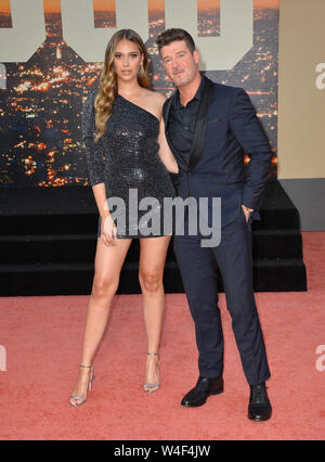 Los Angeles, USA. 22nd July, 2019. LOS ANGELES, USA. July 23, 2019: April Love Geary & Robin Thicke at the premiere of 'Once Upon A Time In Hollywood' at the TCL Chinese Theatre. Picture Credit: Paul Smith/Alamy Live News - Stock Photo