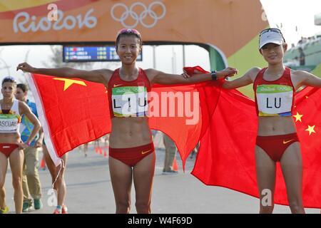 (190723) -- BEIJING, July 23, 2019 (Xinhua) -- China's Liu Hong (L) and Lyu Xiuzhi celebrate after the women's 20km race walk at the 2016 Rio Olympic Games in Rio de Janeiro, Brazil, on Aug. 19, 2016. (Xinhua/Shen Bohan) - Stock Photo