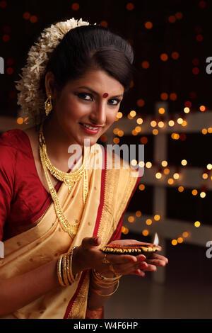 Woman decorating oil lamps in Diwali festival - Stock Photo