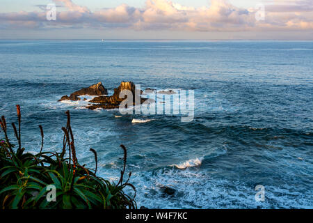 Sunrise at Seal Rock, which is directly offshore from Crescent Bay in Laguna Beach. Seal Rock is typically covered with many shorebirds and sea lions. - Stock Photo
