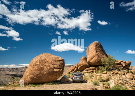 Camping at huge boulder in Gold Butte, former miners town, Gold Butte National Monument, Mojave Desert, Nevada, USA - Stock Photo