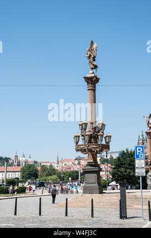Around Prague - Ornate lamppost adjacent to Rudolfinum Building, with angel on the top of stone column - Stock Photo
