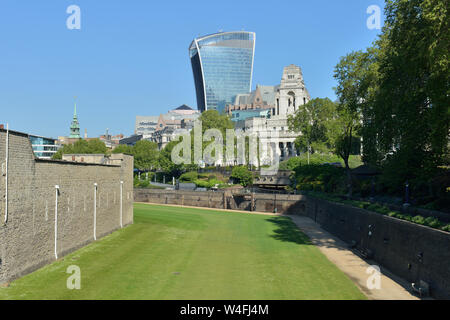 20 Fenchurch street towering over Tower of London moat towards Tower Hill and the City of London, United Kingdom - Stock Photo