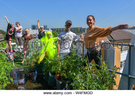 London, England, UK. 23 July 2019: Artists embrace with Mai Nguyen Tri of the Holly Wick sign in preparation for Hackney WickED Open Studios and open its door to public on Hackney Wicked DIY Open Studios Friday 26 July-Sunday 28 July, London, UK. Credit: Picture Capital/Alamy Live News - Stock Photo