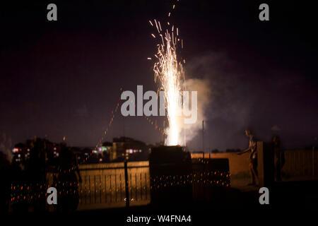 Indian Boy burning fire crackers on Diwali, Sahapur jat Delhi, 26 October 2011 - Stock Photo