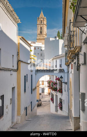 Cuesta de San Juan, alleyway with buttress between buildings, Iglesia de la Asuncion in distance, in Cabra, Cordoba Province, Andalusia, Spain - Stock Photo