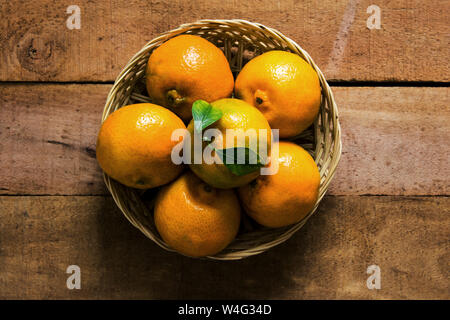 Freshly picked organic manderin on rustic wooden tabletop -produce and healthy lifestyle concept image wih copy space for text. - Stock Photo