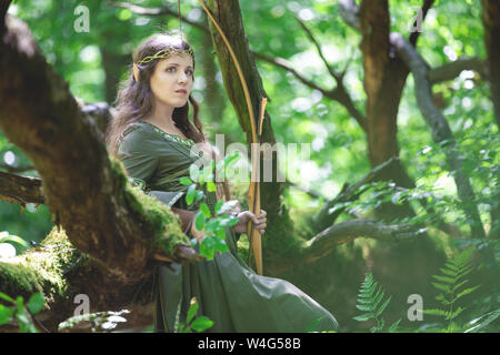 Elf archer with a bow in the forest Stock Photo