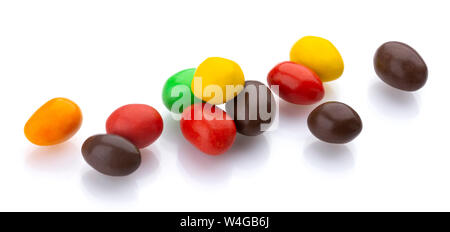 Multicolor shiny nuts and raisins dragee isolated on white background - Stock Photo