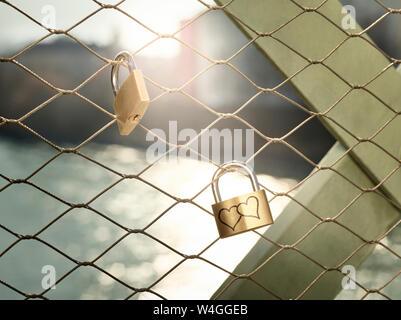 Austria, Wattens, golden love lock with hearts - Stock Photo