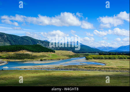 Waiau river and the Southern Alps along the road from Invergargill to Te Anau, South Island, New Zealand - Stock Photo