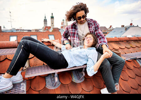 Young couple relaxing on rooftop