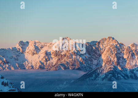 View over snowy mountains at dusk, Saalbach Hinterglemm, Pinzgau, Austria - Stock Photo
