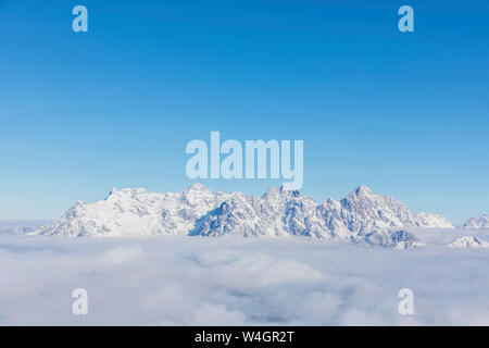 View over snowy mountains at sunshine, Saalbach Hinterglemm, Pinzgau, Austria - Stock Photo