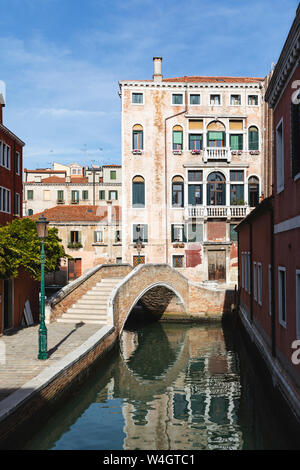 City view with canal, footbridge and typical buildings, Venice, Italy - Stock Photo