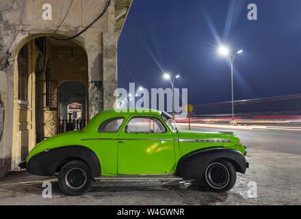 Parked vintage car at night, Havana, Cuba - Stock Photo