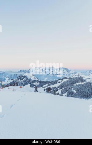 View over snowy mountains at dusk, Saalbach Hinterglemm, Pinzgau, Austria - Stock Photo