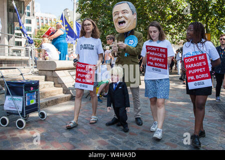 London, UK. 23 July, 2019. Campaigners from Best for Britain protest outside the Queen Elizabeth II Centre with props depicting Boris Johnson as a puppet of Brexit Party leader Nigel Farage prior to the announcement inside the venue that Boris Johnson had been elected as leader of the Conservative Party and would replace Theresa May as Prime Minister. Credit: Mark Kerrison/Alamy Live News - Stock Photo