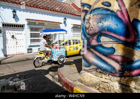 Cartagena Colombia Old Walled City Center centre Getsemani Hispanic historic clay tile roof colonial house exterior wood window grill narrow street gr - Stock Photo