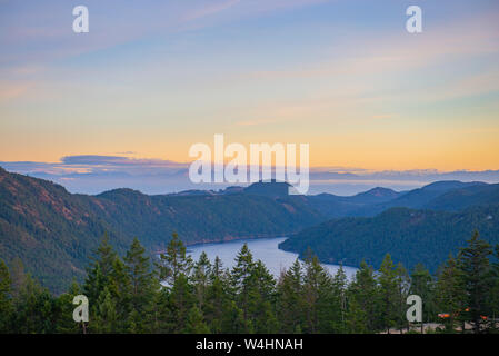 View of the Saanich inlet and gulf islands from the Malahat summit at sunset in Vancouver Island, BC, Canada - Stock Photo