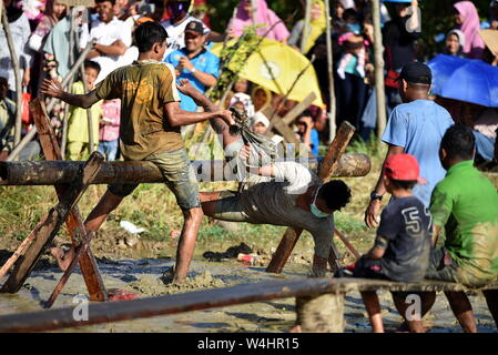 Banda Aceh, Indonesia - August 17, 2017 : Teenagers are compete of Pillow War (Pukul Bantal) to commemorate Indonesia's independence day in Banda Aceh - Stock Photo
