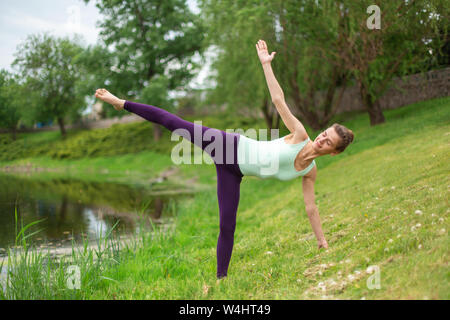 young attractive yogi woman practicing yoga concept